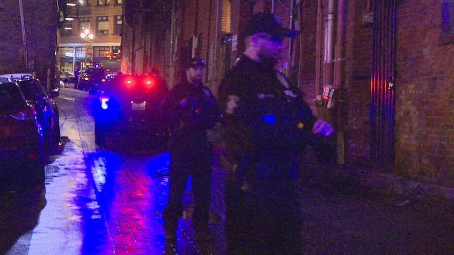 Police gather evidence at the shooting scene in Pioneer Square. Photo: KOMO News Photo