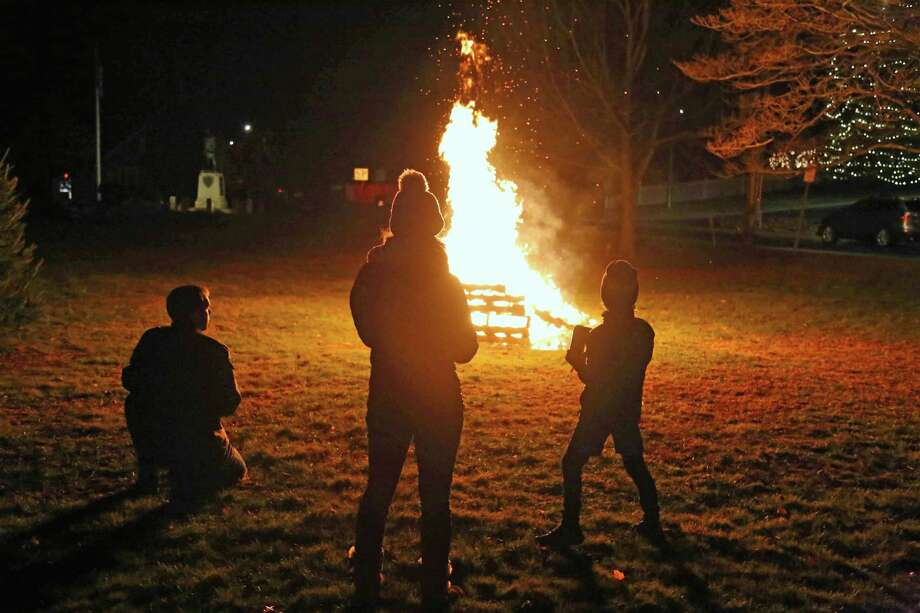 Visitors watch the bonfire on Veterans Green at the Westport Museum for History and Culture's First Light Festival on Dec. 31, 2019 in Westport. Photo: Jarret Liotta / For Hearst Connecticut Media / Jarret Liotta / ©Jarret Liotta
