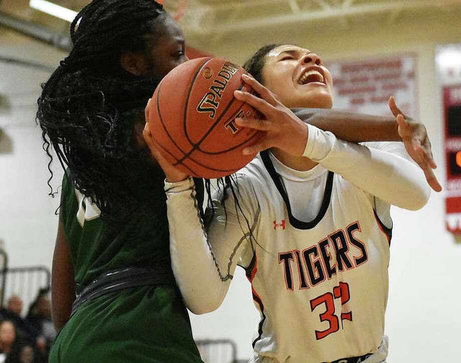 Edwardsville forward Maria Smith is fouled hard as she goes up for a basket during the semifinal game against Whitfield at the Visitation Christmas Tournament. Photo: Matt Kamp|The Intelligencer