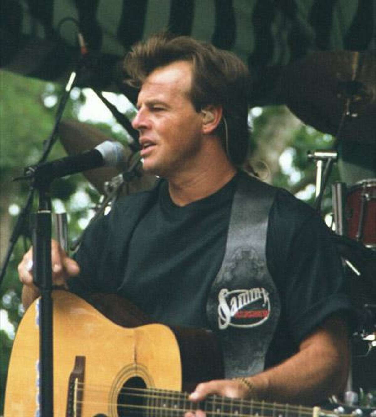 Musician Sammy Kershaw performing on stage