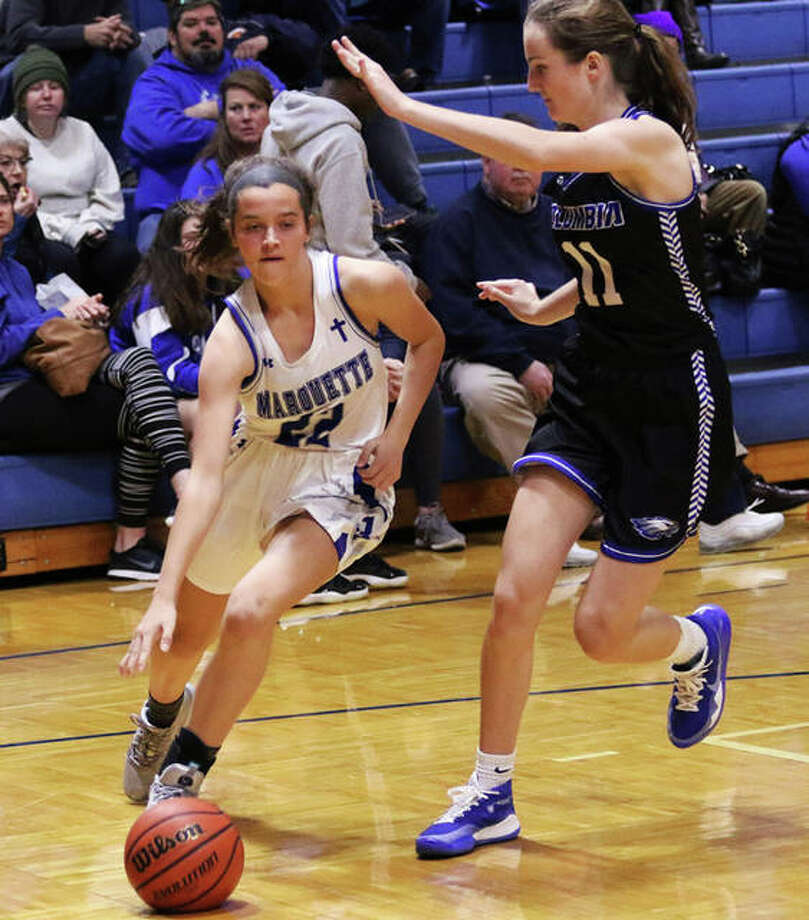 Marquette's Jillian Nelson (left) drives on Columbia's Avrie Barthel in Columbia earlier this season. Nelson and the Explorers finished second in the Jersey Holiday Tournament. Photo: Greg Shashack File | The Telegraph
