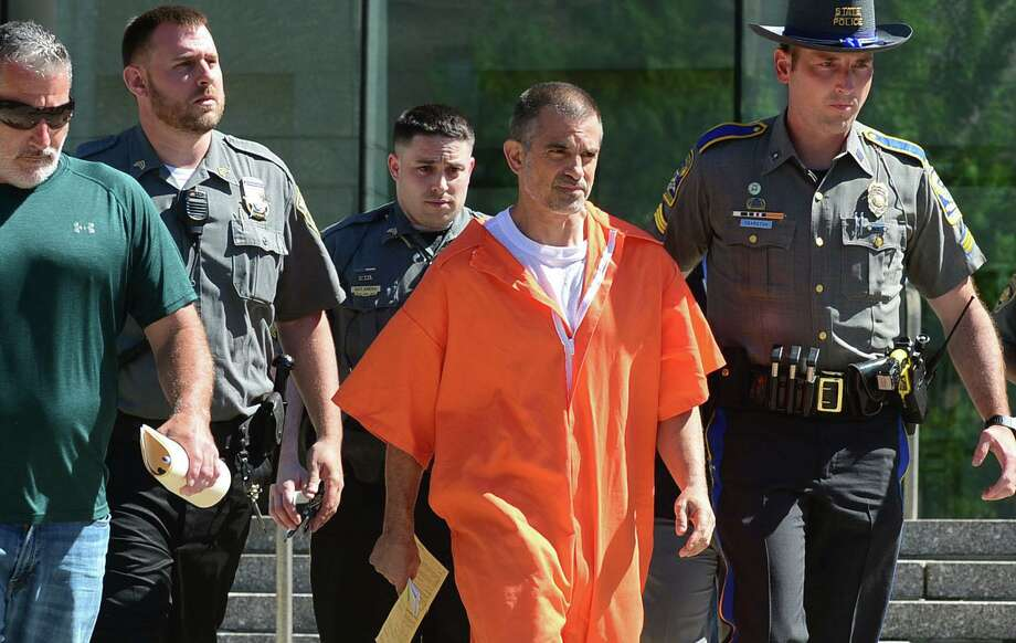 Fotis Dulos exits Stamford Superior Court on June 11 with bondsman, state police and judicial marshals after posting $500,000 bond for charges of tampering with evidence and hindering the investigation into the disappearance of his wife, Jennifer Dulos. Photo: Erik Trautmann / Hearst Connecticut Media / Norwalk Hour
