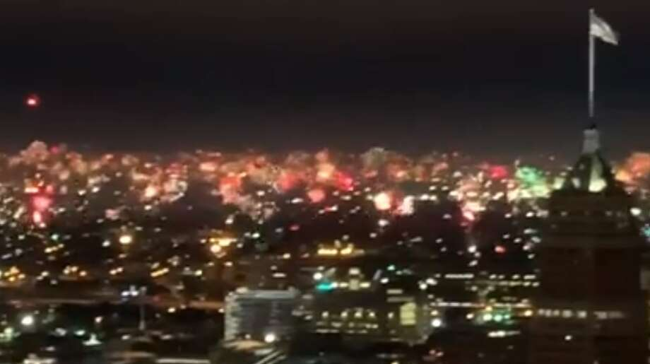 Video shows New Year's Eve fireworks simultaneously erupting across San Antonio skyline. Photo: Mac Jones
