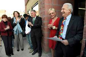 Business owners Larry Mokhiber, right, and his wife Kathy Mokhiber, second from right, celebrate the moment during the grand re-opening of Albany's oldest family-run liquor store on Wednesday, Dec. 9, 2015, at Mokhiber's Wines and Liquors in Albany, N.Y. Joining them are Mayor Kathy Sheehan, left, and assembly members Patricia Fahy, second from left, and John T. McDonald III, center. (Cindy Schultz / Times Union)
