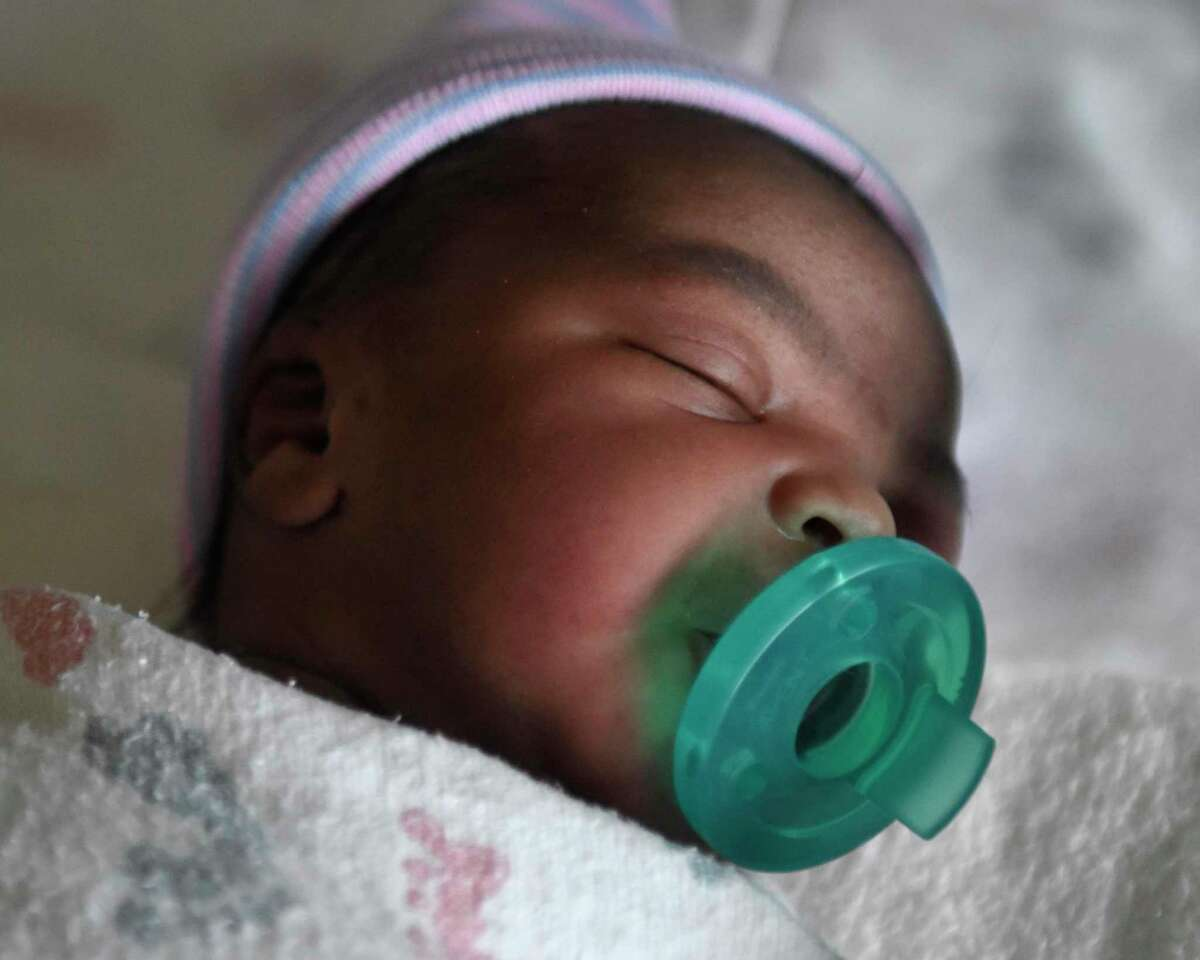 The first Stamford baby born in 2020 rests at Stamford Hospital on Wednesday. The girl, who is not yet named, was born at 1:49 a.m. weighing 7 pounds, 15 ounces. The baby was born to Stamford mother Bercy Duperval, who shares a New Years Day birthday with her newborn.