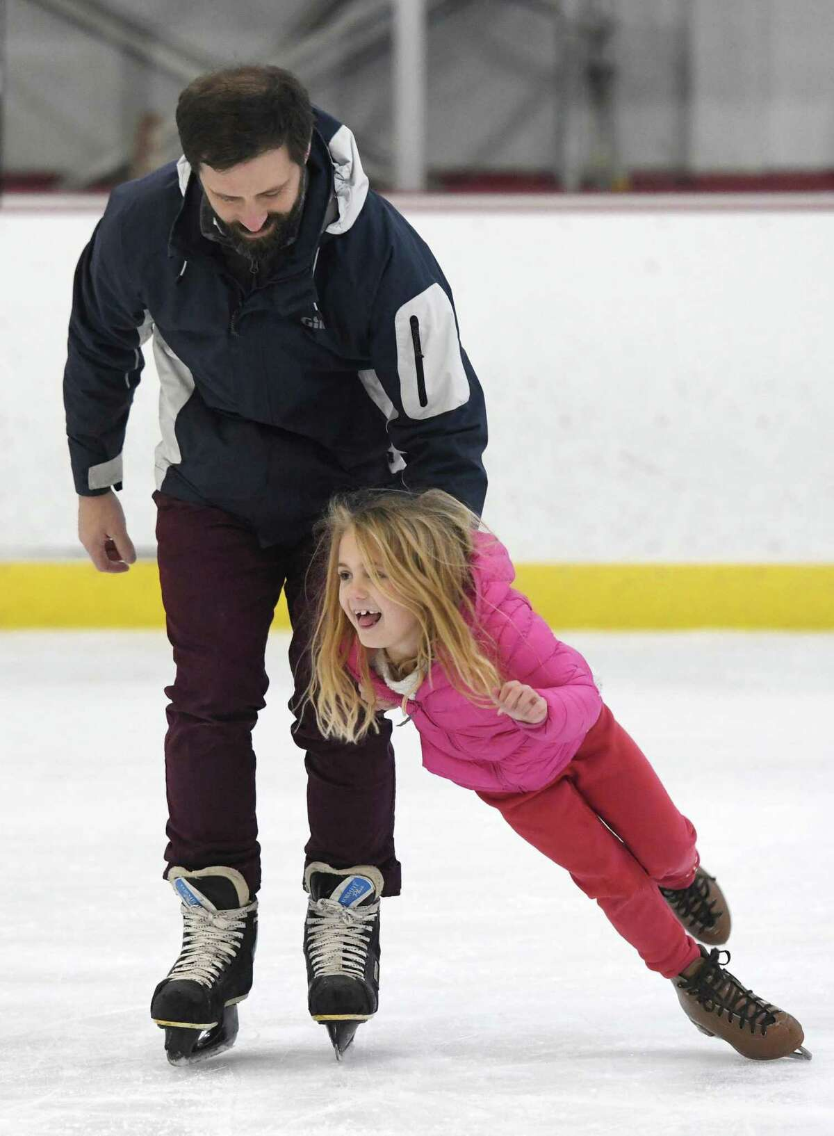 Old Greenwich's Tom O'Connor helps his daughter Kellan O'Connor, 6, from falling while skating during the open skating session at Dorothy Hamill Rink in the Byram section of Greenwich, Conn. Monday, Dec. 30, 2019. The rink offers public skating from noon to 1:30 p.m. every weekday and from 2 p.m. to 4 p.m. on Saturday and Sunday.