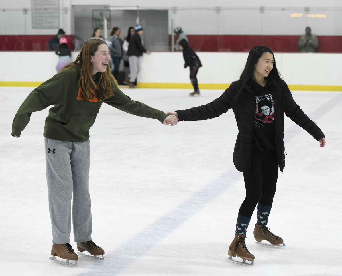 Greenwich girls Anne Roth, left, and Stephanie Chang, both 14, skate during the open skating session at Dorothy Hamill Rink in the Byram section of Greenwich, Conn. Monday, Dec. 30, 2019. The rink offers public skating from noon to 1:30 p.m. every weekday and from 2 p.m. to 4 p.m. on Saturday and Sunday.