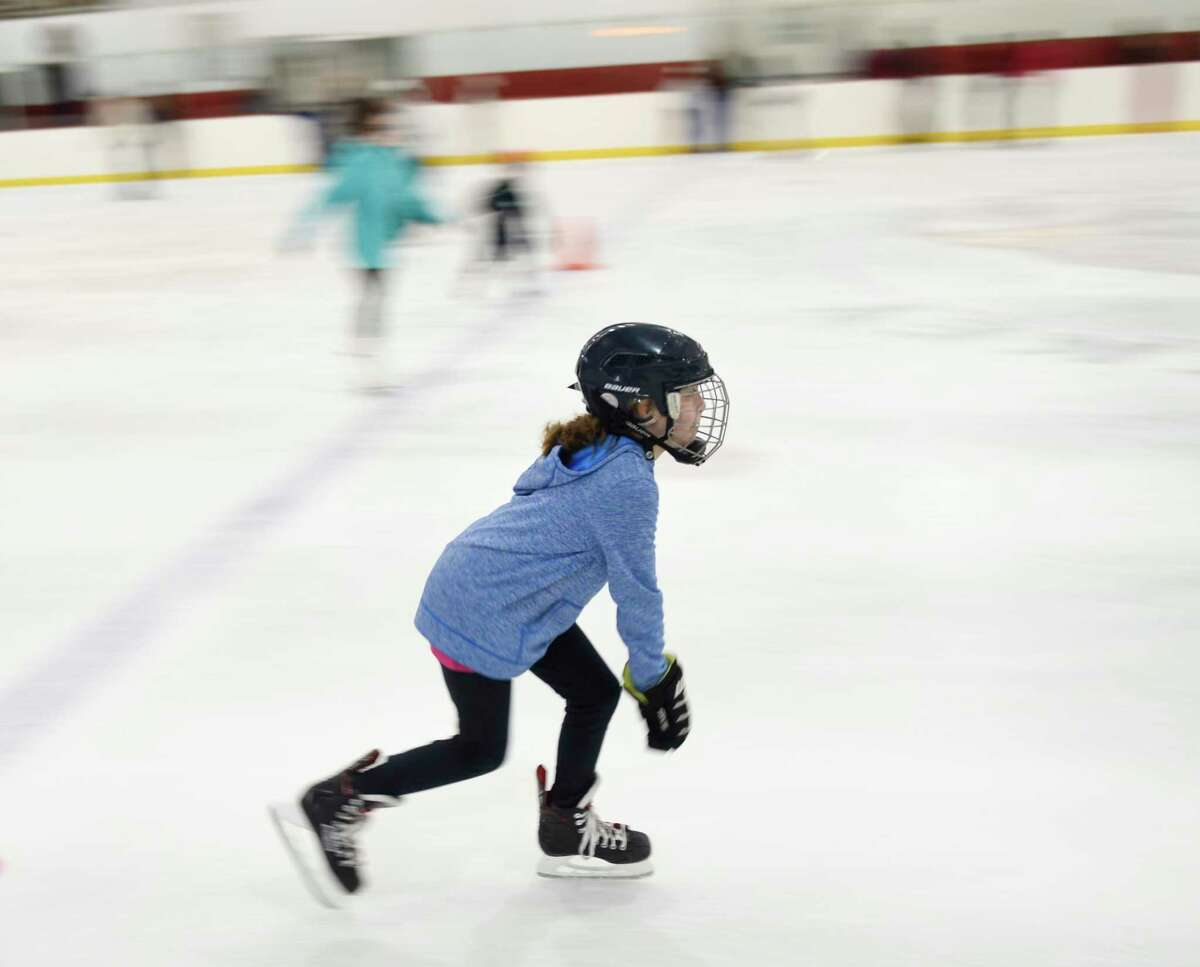 Greenwich's Keeghan Kortener, 10, skates during the open skating session at Dorothy Hamill Rink in the Byram section of Greenwich, Conn. Monday, Dec. 30, 2019. The rink offers public skating from noon to 1:30 p.m. every weekday and from 2 p.m. to 4 p.m. on Saturday and Sunday.