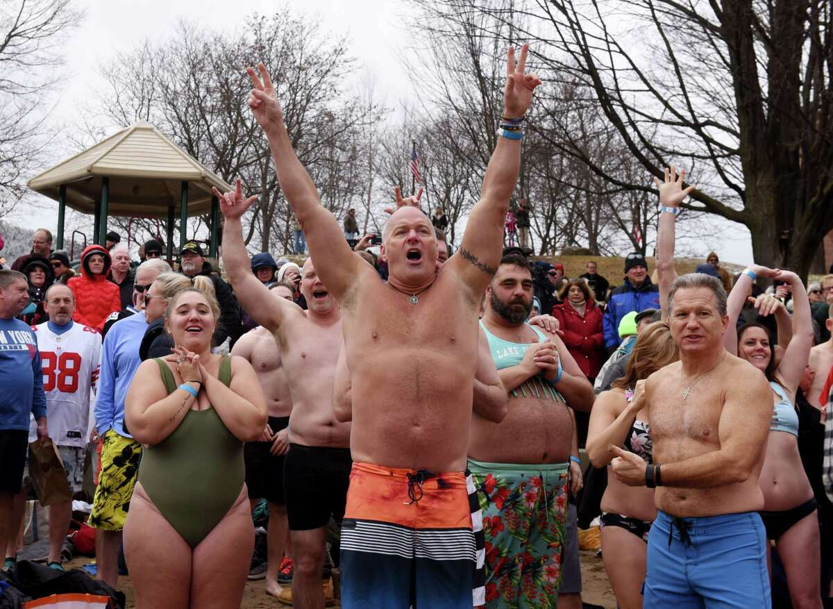 Revelers prepare to run into Lake George during the annual New Year's Day Polar Plunge on Wednesday, Jan. 1, 2020, at Shepard Park Beach in Lake George, N.Y. (Will Waldron/Times Union)