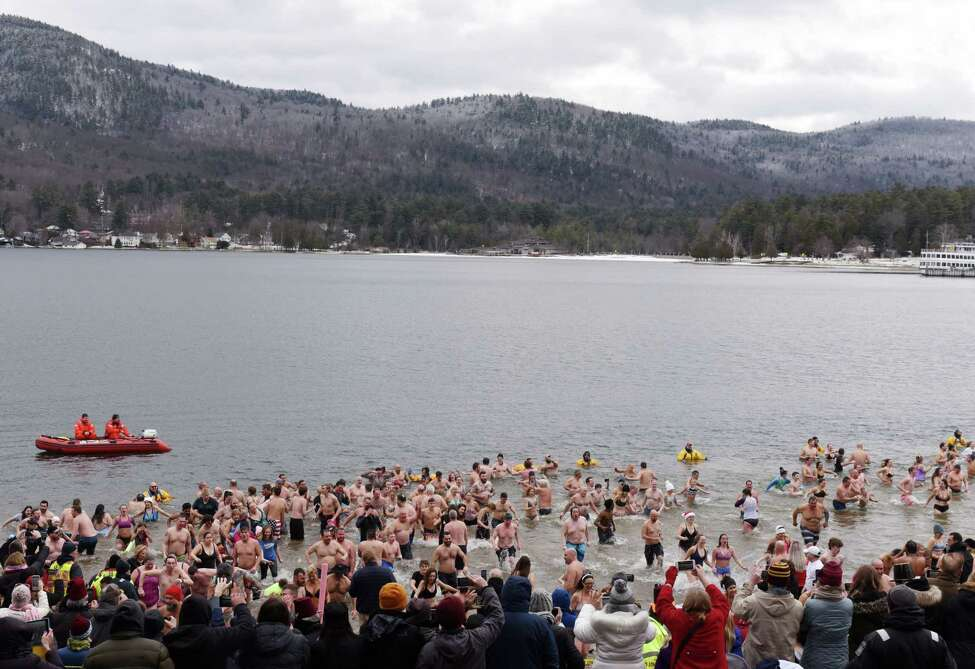 Swimmers revel in the icy waters of Lake George during the annual New Year's Day Polar Plunge on Wednesday, Jan. 1, 2020, at Shepard Park Beach in Lake George, N.Y. (Will Waldron/Times Union)