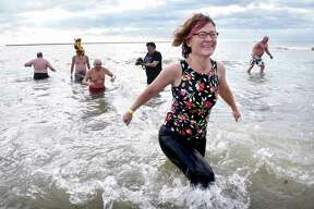 Participants in the annual Plunge for the Parks sponsored by the Elm City Parks Conservancy run into the Long Island Sound at Lighthouse Point Park in New Haven on New Year's Day January 1, 2020.