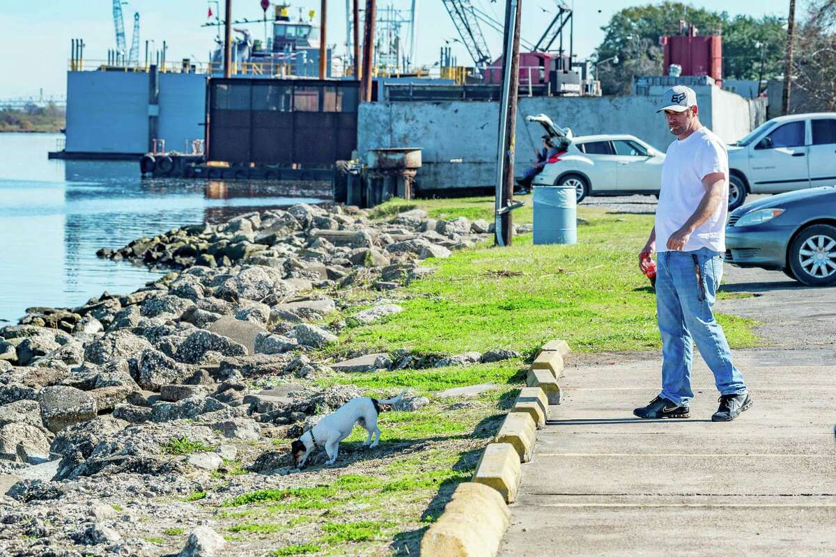 Donovan Broussard walks his dog Bodie along the riverfront in Port Neches near the boat ramps on Tuesday, December 24, 2019. Broussard thinks it would be good for the city of Port Neches to construct a walkway along the riverfront. Fran Ruchalski/The Enterprise