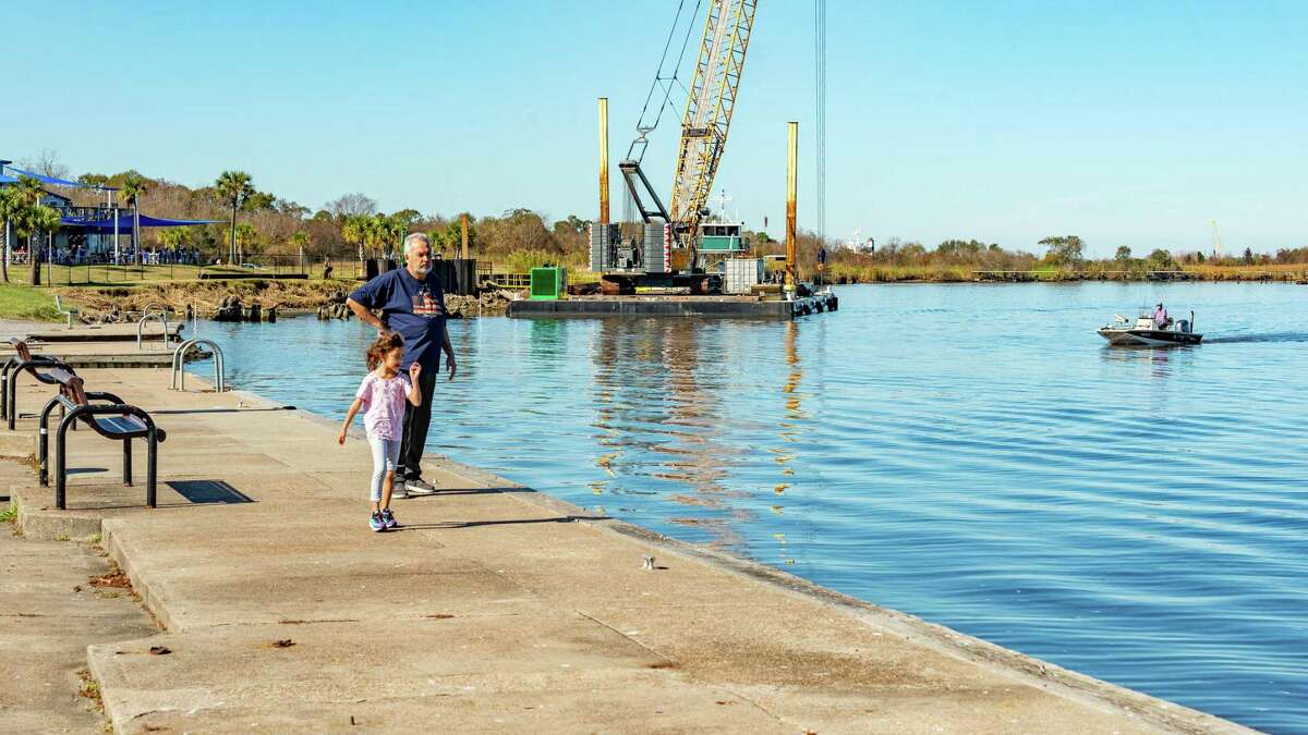 Six-year-old Ava Simonovis walks along the Port Neches riverfront with her grandfather Fedor Simonovis onTuesday, December 24, 2019. The elder Simonovis thinks constructing a walkway along the riverfront would be a good idea, and mentioned the city might want to consider a water taxi on the river especially for visitors to see the river. Fran Ruchalski/The Enterprise