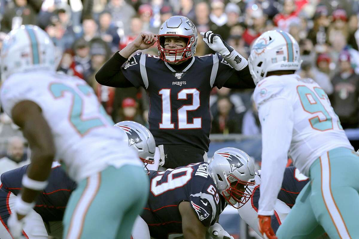 New England Patriots quarterback Tom Brady calls signals at the line of scrimmage against the Miami Dolphins in the first half of an NFL football game, Sunday, Dec. 29, 2019, in Foxborough, Mass. (AP Photo/Charles Krupa)