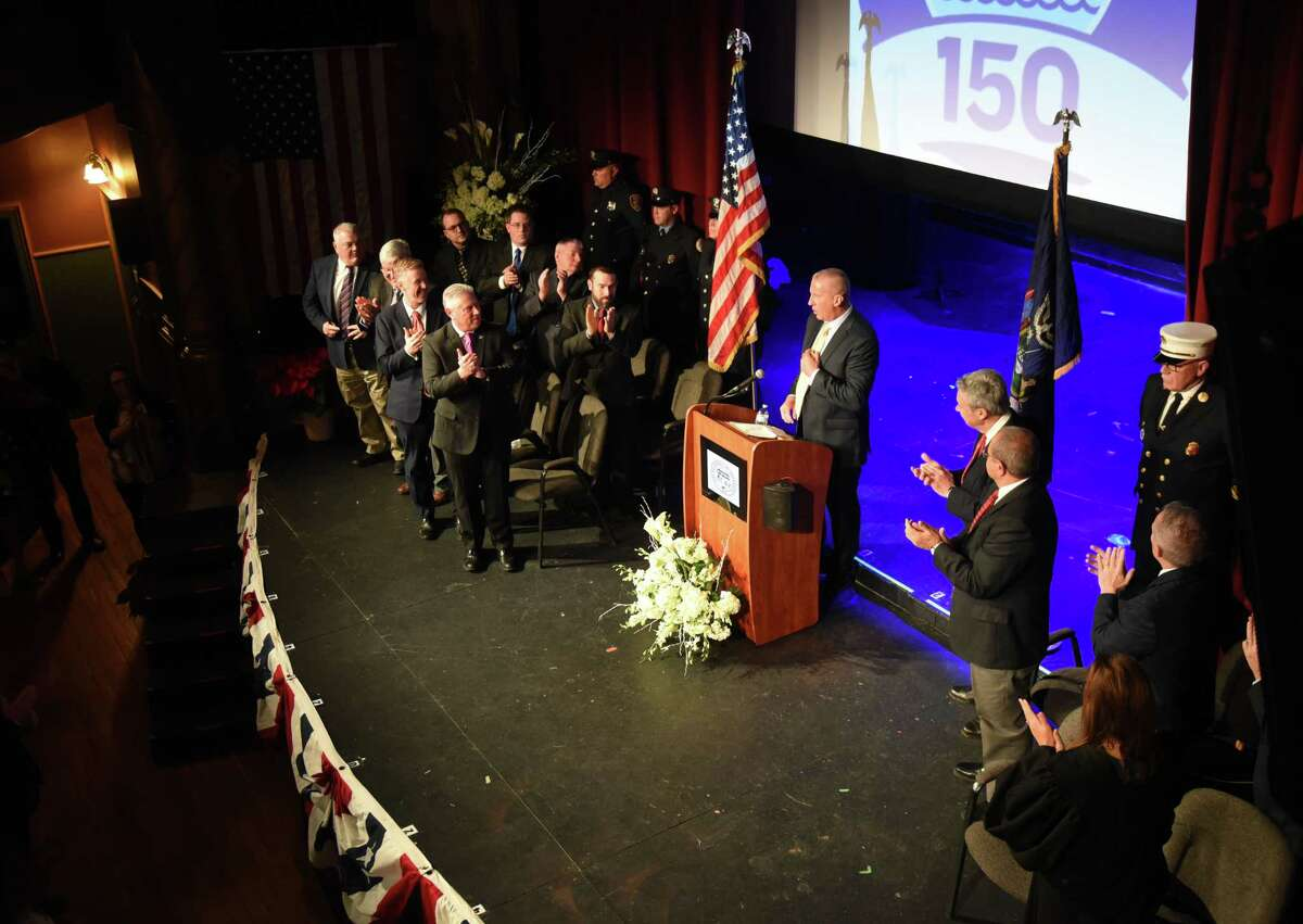 Cohoes Mayor William Keeler is applauded during his swearing-in ceremony on Wednesday, Jan. 1, 2020, at Cohoes Music Hall in Cohoes, N.Y. The retired State Police major starts his term following the resignation of disgraced former mayor Shawn Morse. (Will Waldron/Times Union)