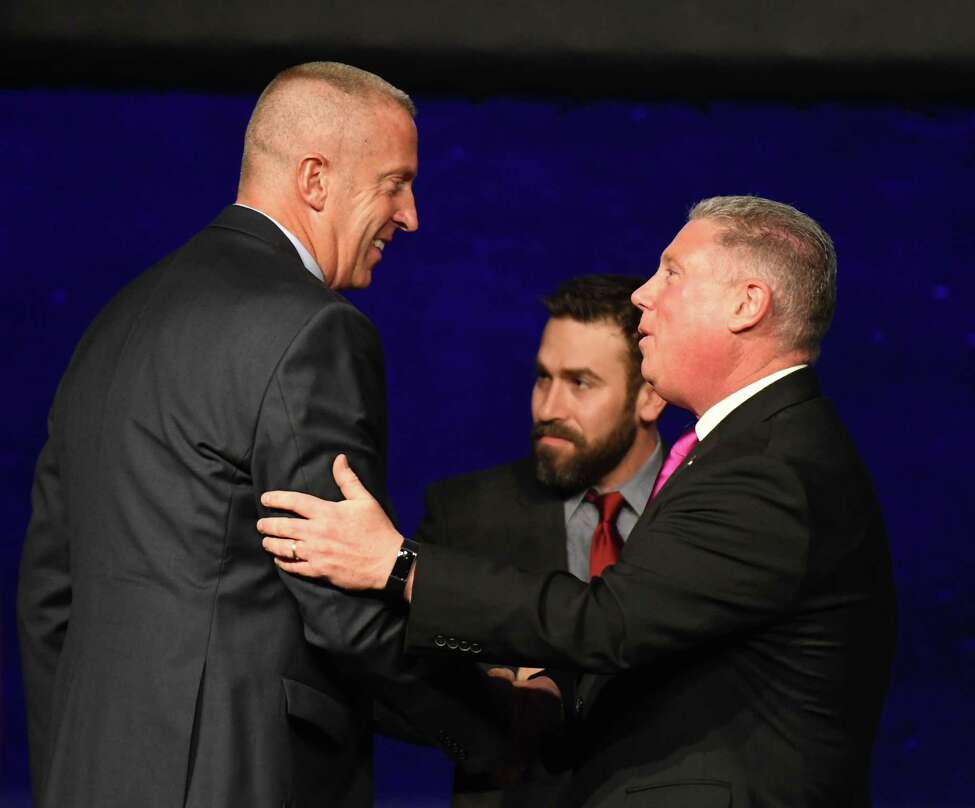 Cohoes Mayor William Keeler, left, is congratulated by Assemblyman John T. McDonald III, right, during a swearing-in ceremony on Wednesday, Jan. 1, 2020, at Cohoes Music Hall in Cohoes, N.Y. The retired State Police major starts his term following the resignation of disgraced former mayor Shawn Morse. (Will Waldron/Times Union)