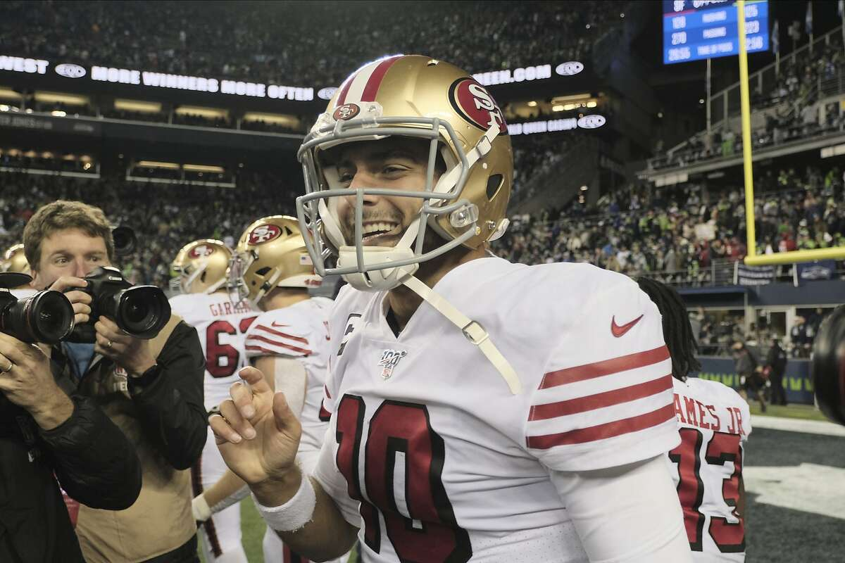 San Francisco 49ers quarterback Jimmy Garoppolo reacts after the team beat the Seattle Seahawks in an NFL football game, Sunday, Dec. 29, 2019, in Seattle. (AP Photo/Stephen Brashear)