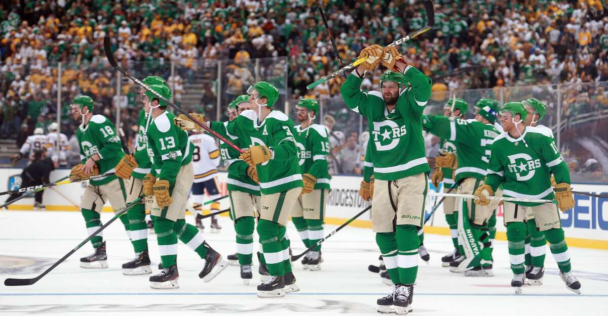 DALLAS, TEXAS - JANUARY 01: The Dallas Stars celebrate a 4-2 win over the Nashville Predators at the Cotton Bowl on January 01, 2020 in Dallas, Texas. (Photo by Richard Rodriguez/Getty Images)