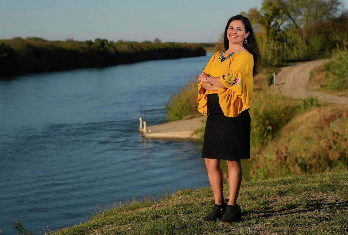 Tricia Cortez stands along the Rio Grande riverbanks on Monday. Cortez was named the 2019 LMT Laredoan of the Year for her work with the Rio Grande International Study Center and their mission to protect the river and fight the border wall.