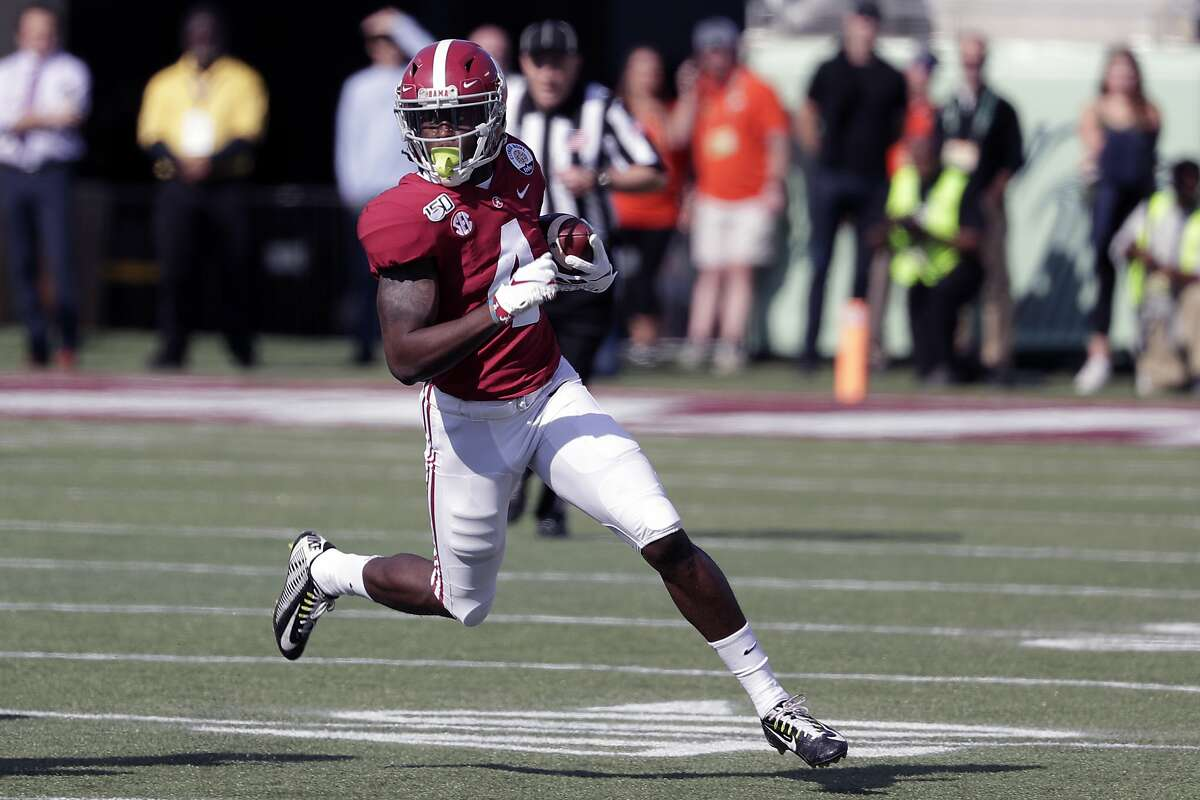 Alabama wide receiver Jerry Jeudy (4) runs after a reception against Michigan during the first half of the Citrus Bowl NCAA college football game, Wednesday, Jan. 1, 2020, in Orlando, Fla. (AP Photo/John Raoux)