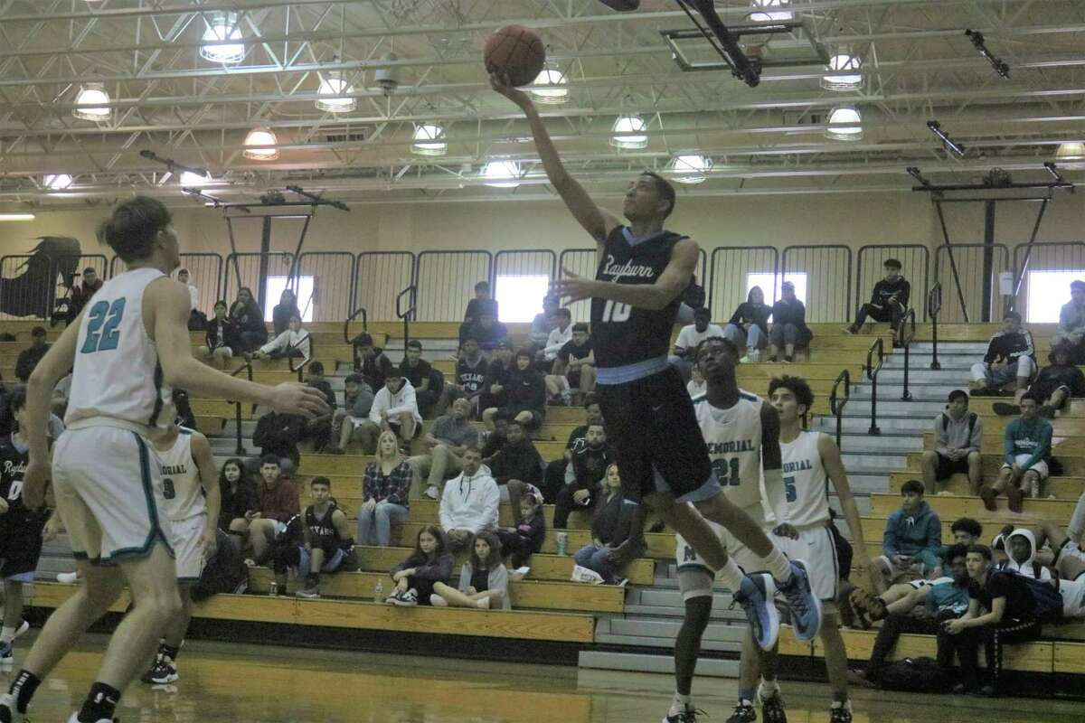 Sam Rayburn's Jaylen White goes up for two of 23 points during Tuesday's district game.
