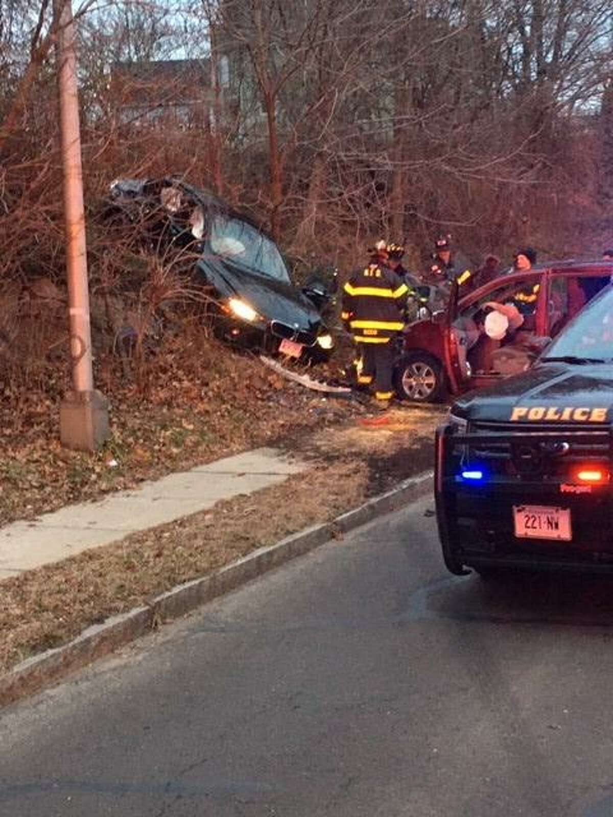 Firefighters work the scene of a serious accident on Martin Luther King Drive.