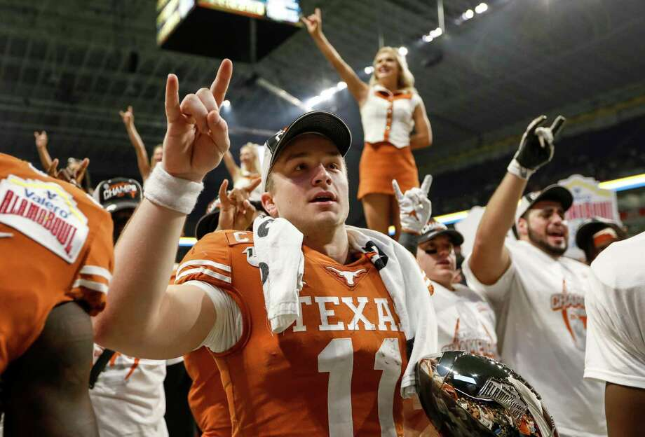 SAN ANTONIO, TX - DECEMBER 31: Sam Ehlinger #11 of the Texas Longhorns celebrates with the MVP Trophy after the Valero Alamo Bowl game against the Utah Utes at the Alamodome on December 31, 2019 in San Antonio, Texas. (Photo by Tim Warner/Getty Images) Photo: Tim Warner, Stringer / Getty Images / 2019 Getty Images