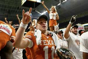 SAN ANTONIO, TX - DECEMBER 31: Sam Ehlinger #11 of the Texas Longhorns celebrates with the MVP Trophy after the Valero Alamo Bowl game against the Utah Utes at the Alamodome on December 31, 2019 in San Antonio, Texas. (Photo by Tim Warner/Getty Images)
