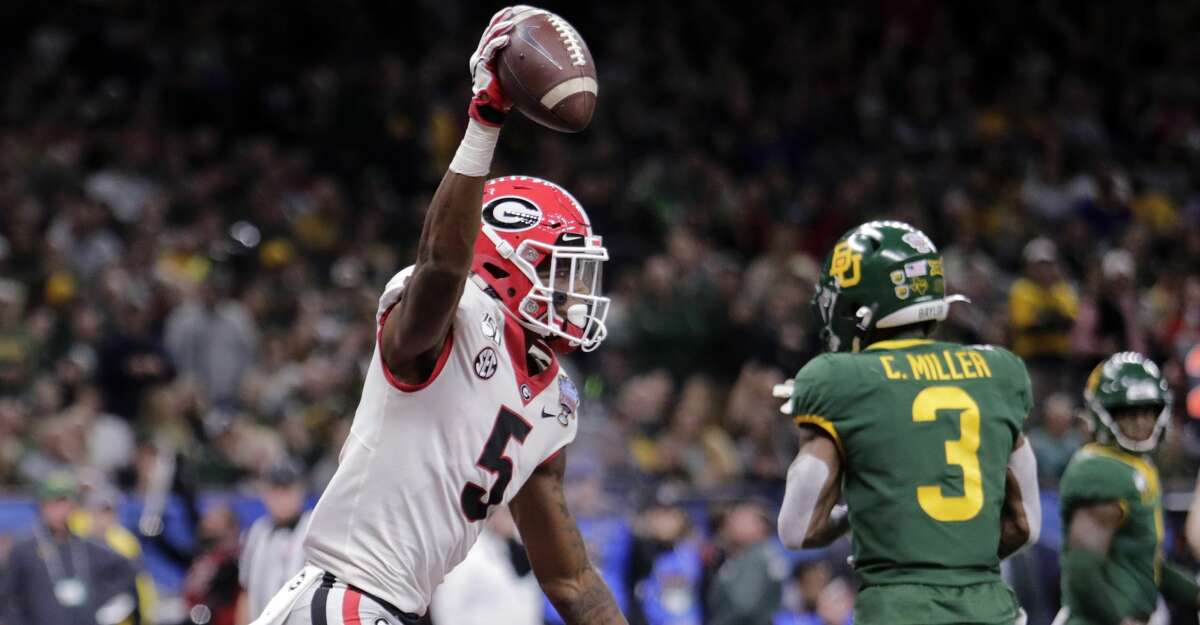 Georgia wide receiver Matt Landers (5) celebrates his touchdown reception in the first half of the Sugar Bowl NCAA college football game against Baylor in New Orleans, Wednesday, Jan. 1, 2020. (AP Photo/Brett Duke)