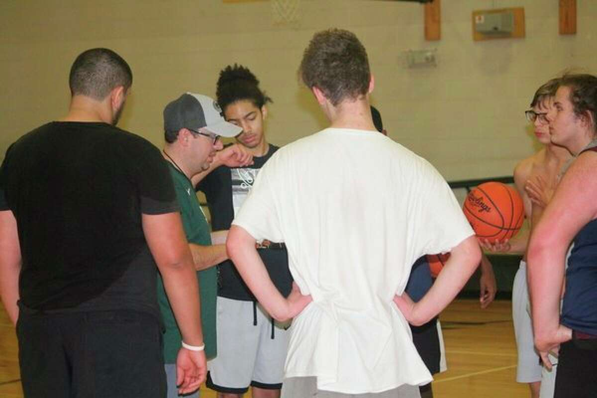 Baldwin coach JJ Eads (second from left) talks with his players after a Monday practice. (Pioneer photo/John Raffel)