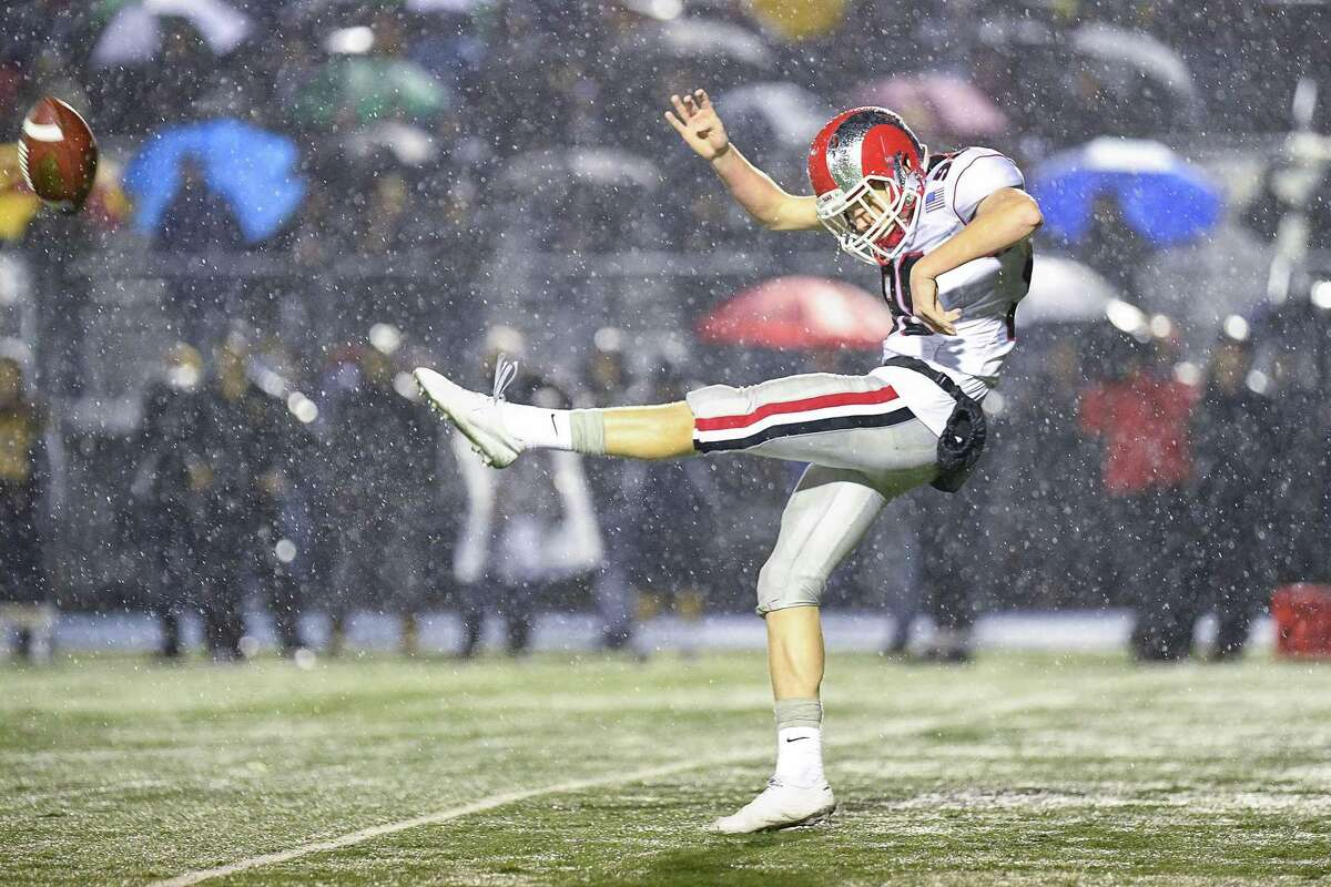 New Canaan punter Nicholas Radman in the CIAC Class L Semi-final game at Bunnell High School, Monday December 9, 2019