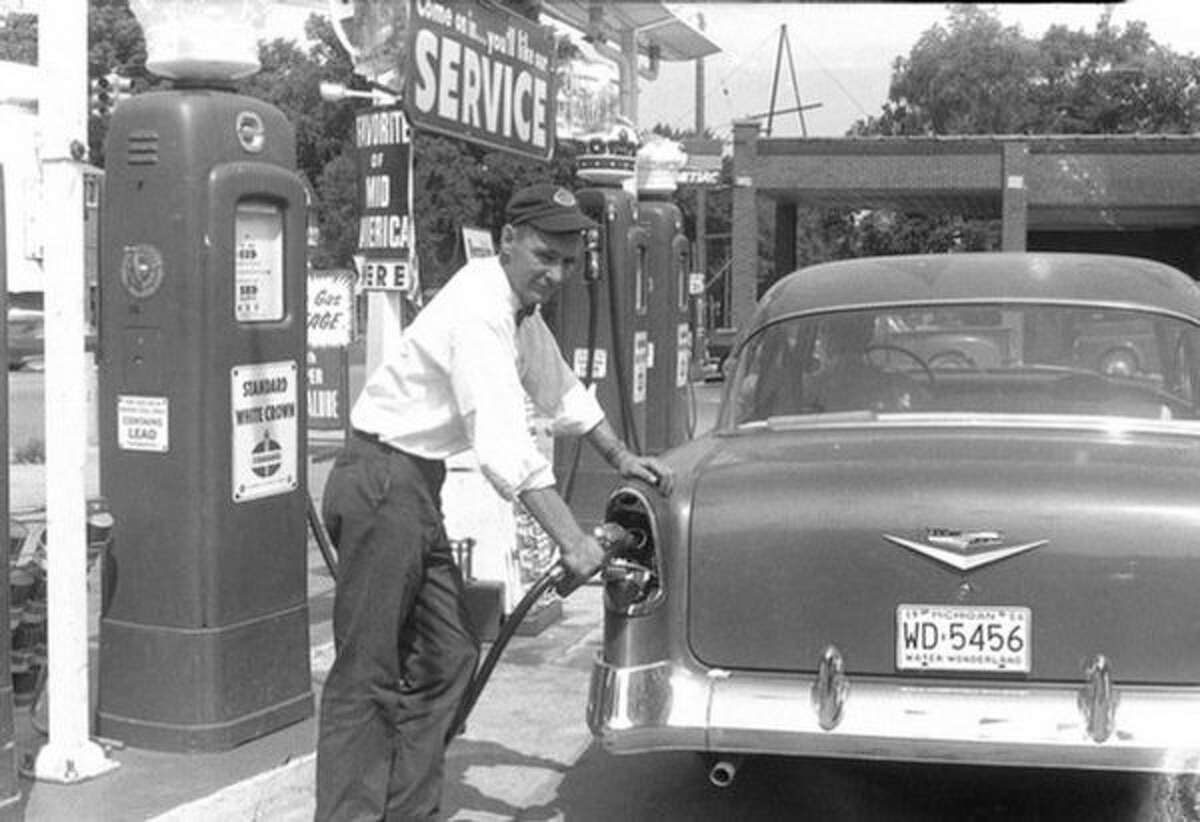 """Rich """"Dick"""" Currie is pictured in this 1956 photo pumping gas at a station he owned in Big Rapids. Currie's death in 1996 prompted his son, Pat, to post an """"RIP"""" message on the marquee of the gas station he owned in Big Rapids. More than 20 years later, Pat Currie continues to use his gas station's marquee to inform drivers and passersby of local happenings. (Courtesy photo)"""
