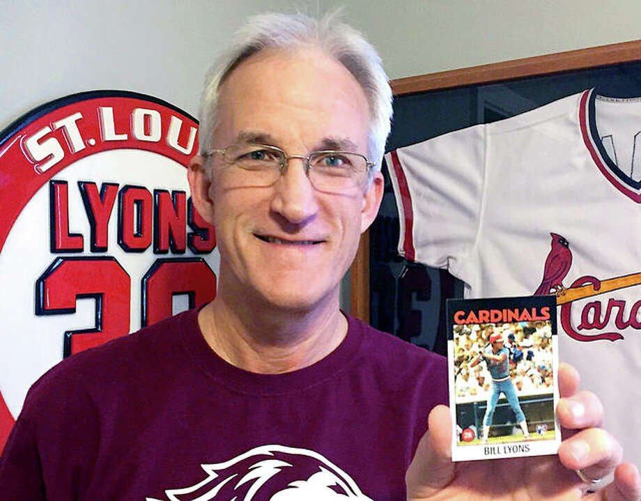 Alton native Bill Lyons with his Cardinals Topps baseball card which was given to him as a Christmas gift by his family. Lyons, an Alton High and SIU Carbondale grad, played half of the 1983 and 1984 seasons with the Cardinals, but Topps did not make a Lyons baseball card since his one-year in MLB was spread over two sesons. Lyons' family consulted Topps and had the card made for him. Lyons lives in Heyworth, Illinois. Photo: For The Telegraph