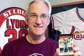 Alton native Bill Lyons with his Cardinals Topps baseball card which was given to him as a Christmas gift by his family. Lyons, an Alton High and SIU Carbondale grad, played half of the 1983 and 1984 seasons with the Cardinals, but Topps did not make a Lyons baseball card since his one-year in MLB was spread over two sesons. Lyons' family consulted Topps and had the card made for him. Lyons lives in Heyworth, Illinois.
