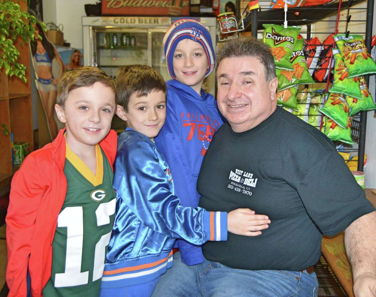 West Lane Deli owner John Saoulidis with Chris Curran's boys in late 2019.