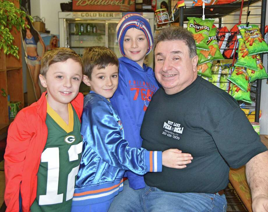 West Lane Deli owner John Saoulidis with Chris Curran's boys in late 2019. Photo: Nicole Zappone / Hearst Connecticut Media