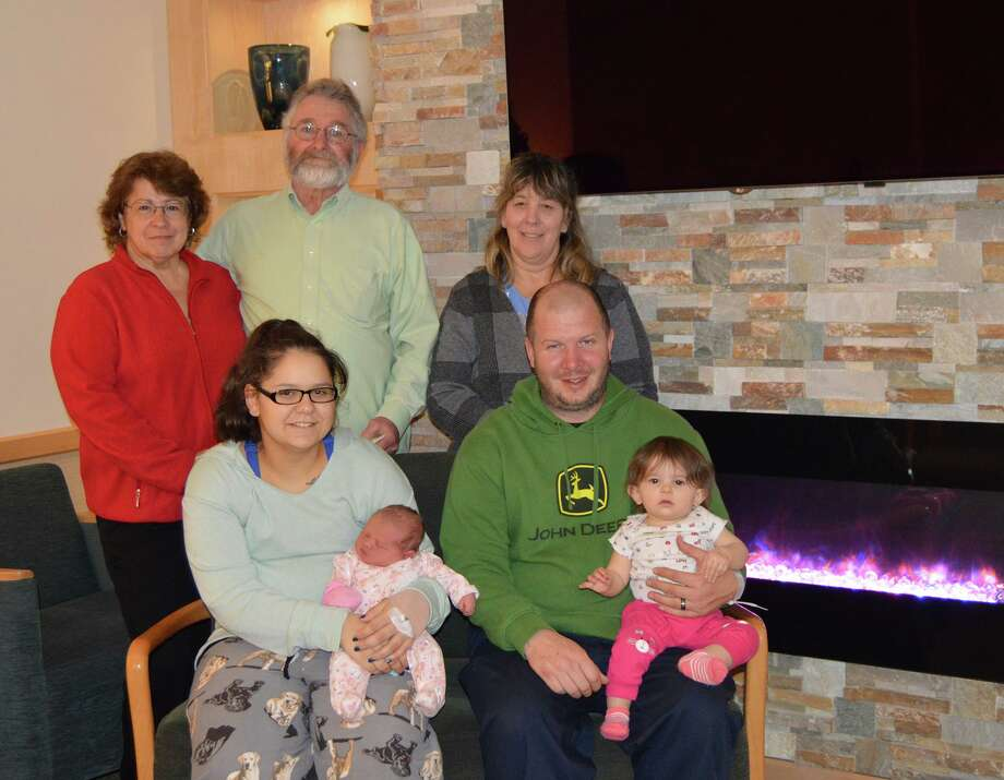 Celebrating Arabella's birth in the family room of the Childbirth Center at Griffin Hospital are Arabella's great-grandparents, Debra and Larry Woodcock, her grandmother, Diana Venice, her mother, Taylor, father, Dave and sister, Emerie. Photo: Contributed Photo.