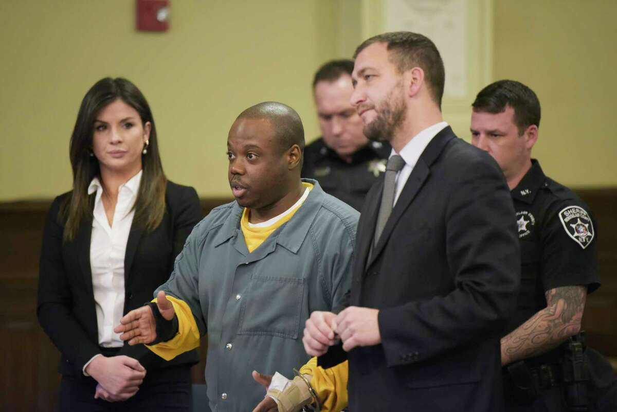 James White, left, and his attorney, Kurt Haas appear in Rensselaer County Court for a suppression hearing on Thursday, Jan. 2, 2020, in Troy, N.Y. White is charged with murder in the December 2017 killings of Brandi Mells, Shanta Myers, and Myers' children, Jeremiah Myers, and Shanise Myers. (Paul Buckowski/Times Union)
