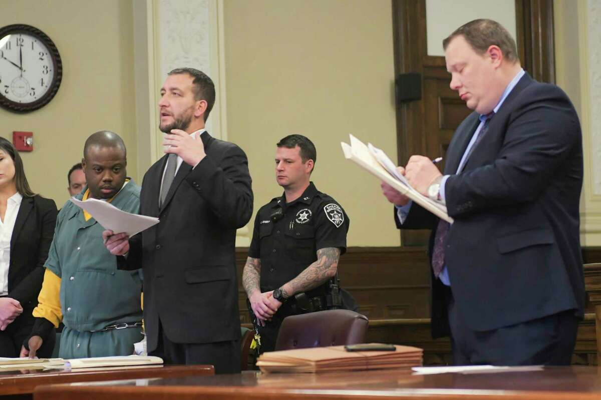 James White, left, and his attorney, Kurt Haas, second from left, and Matthew Hauf, right, the Rensselaer County chief assistant district attorney appear in Rensselaer County Court for a suppression hearing on Thursday, Jan. 2, 2020, in Troy, N.Y. White is charged with murder in the December 2017 killings of Brandi Mells, Shanta Myers, and Myers' children, Jeremiah Myers, and Shanise Myers. (Paul Buckowski/Times Union)