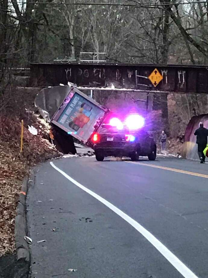 New Canaan police respond to a box truck collision with the bridge on Route 106 in New Canaan, Connecticut on New Year's Eve, Tuesday, Dec. 31, 2019, at 4:21 p.m. New Canaan resident Jan Archer says she was one of the first people on the scene. Photo: Jan Archer / Contributed Photo