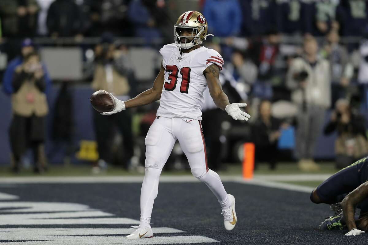 San Francisco 49ers' Raheem Mostert scores a touchdown against the Seattle Seahawks during the second half of an NFL football game, Sunday, Dec. 29, 2019, in Seattle. (AP Photo/Stephen Brashear)