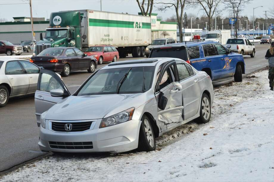 A two-car accident took place at about 11 a.m. Thursday, Jan. 2 on Saginaw Road in Midland, near the intersection of Eastman Avenue. A Midland Police Department officer said the accident was caused by one of the cars running a red light. (Ashley Schafer/Ashley.Schafer@hearstnp.com) Photo: Ashley Schafer