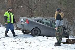 A two-car accident took place at about 11 a.m. Thursday, Jan. 2 on Saginaw Road in Midland, near the intersection of Eastman Avenue. A Midland Police Department officer said the accident was caused by one of the cars running a red light. (Ashley Schafer/Ashley.Schafer@hearstnp.com)