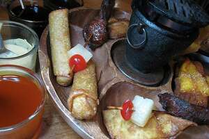 The pu pu platter includes egg rolls, crab puffs, skewered beef, fried wontons, shrimp puffs and chicken wings at Formosa Garden.