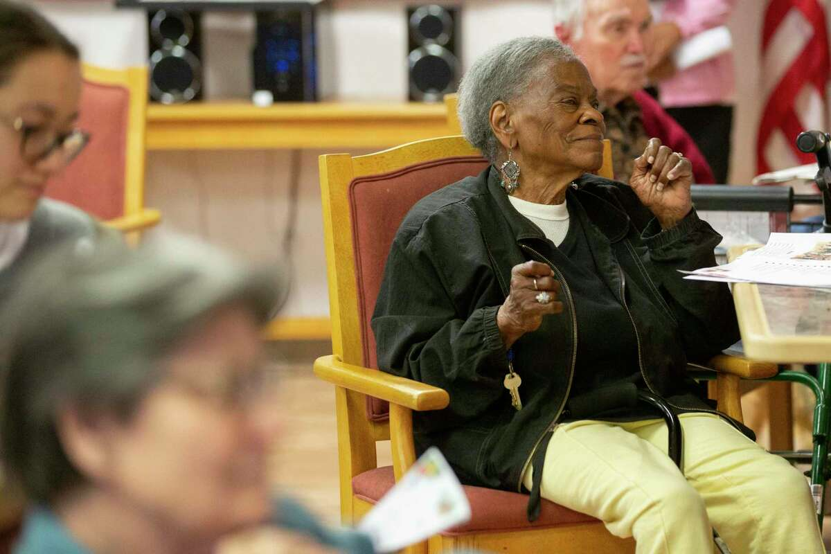 Althea shackelford, 88, a former teacher, follows the rhythm of Christmas music interpreted by the musical group Power of Music at the St Dominic Village on Saturday, Dec. 21, 2019, in Houston.