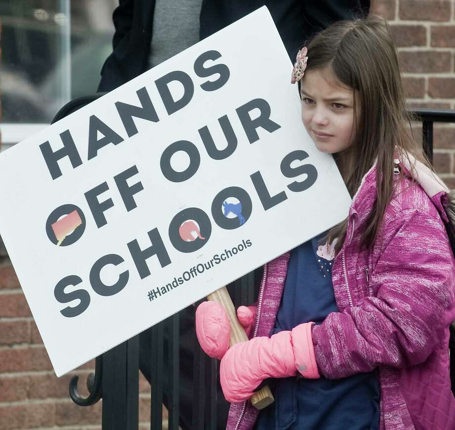 Savannah Quick, 9 of Wilton, holds a sign at a rally against Senate Bill 454, held in front of Town Hall in Ridgefield. Saturday, Feb. 23, 2019 Photo: Scott Mullin / For Hearst Connecticut Media / The News-Times Freelance