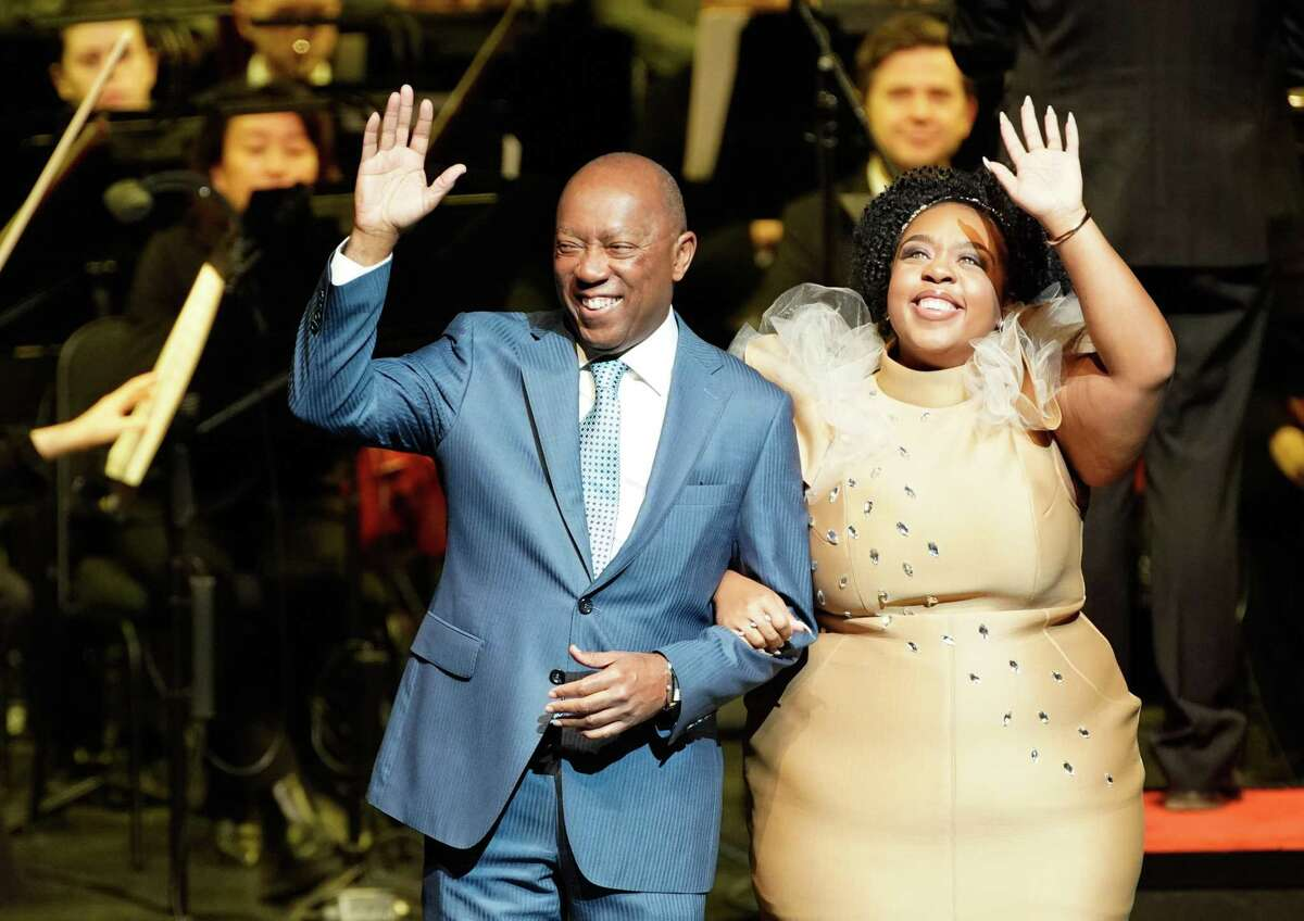 Mayor Sylvester Turner and his daughter, Ashley Turner, are introduced during the inauguration for the mayor, City Controller Chris Brown, and a number of city council members at the Wortham Center Thursday, Jan. 2, 2020.