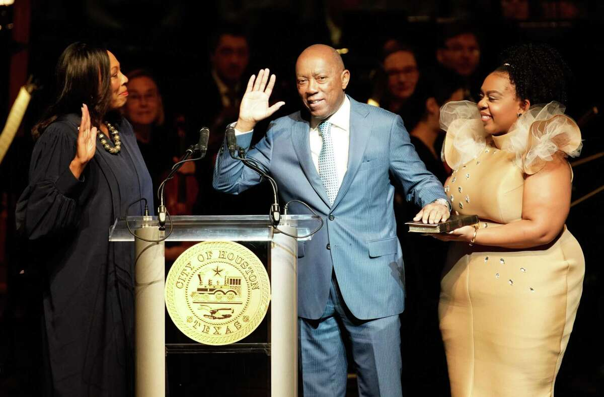 Judge Vanessa Gilmore leads the swearing-in for Mayor Sylvester Turner with his daughter, Ashley Turner, during the inauguration for the mayor, City Controller Chris Brown, and a number of city council members at the Wortham Center Thursday, Jan. 2, 2020.
