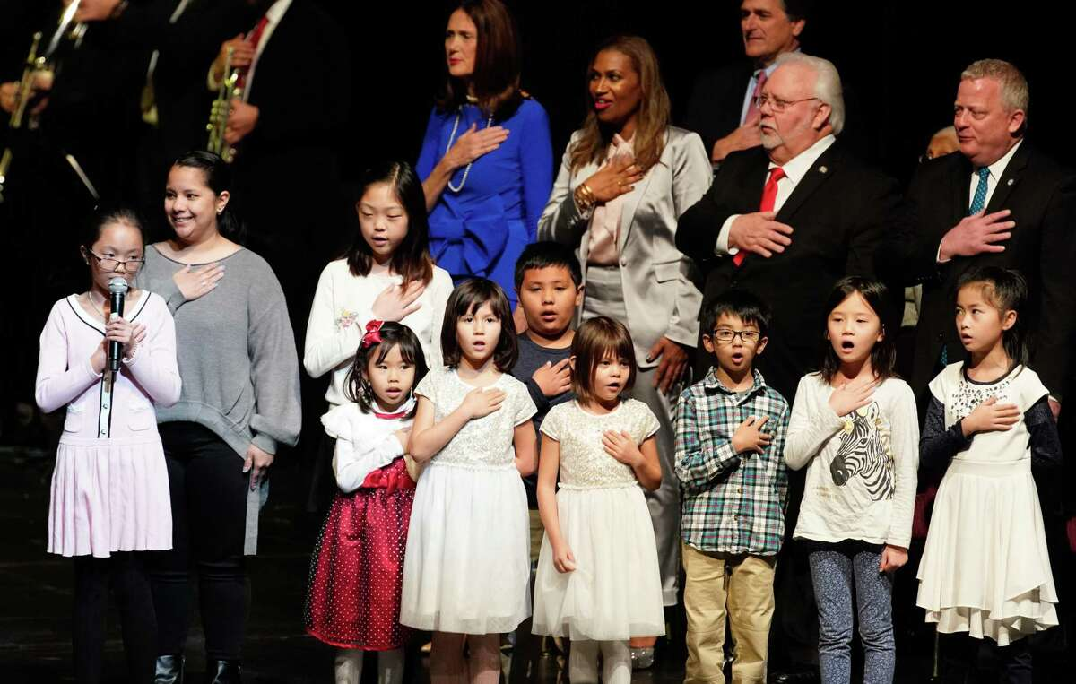 Children from the Chinese Community Center lead the Pledge of Allegiance during the City of Houston inauguration for the mayor, City Controller Chris Brown, and a number of city council members at the Wortham Center Thursday, Jan. 2, 2020.