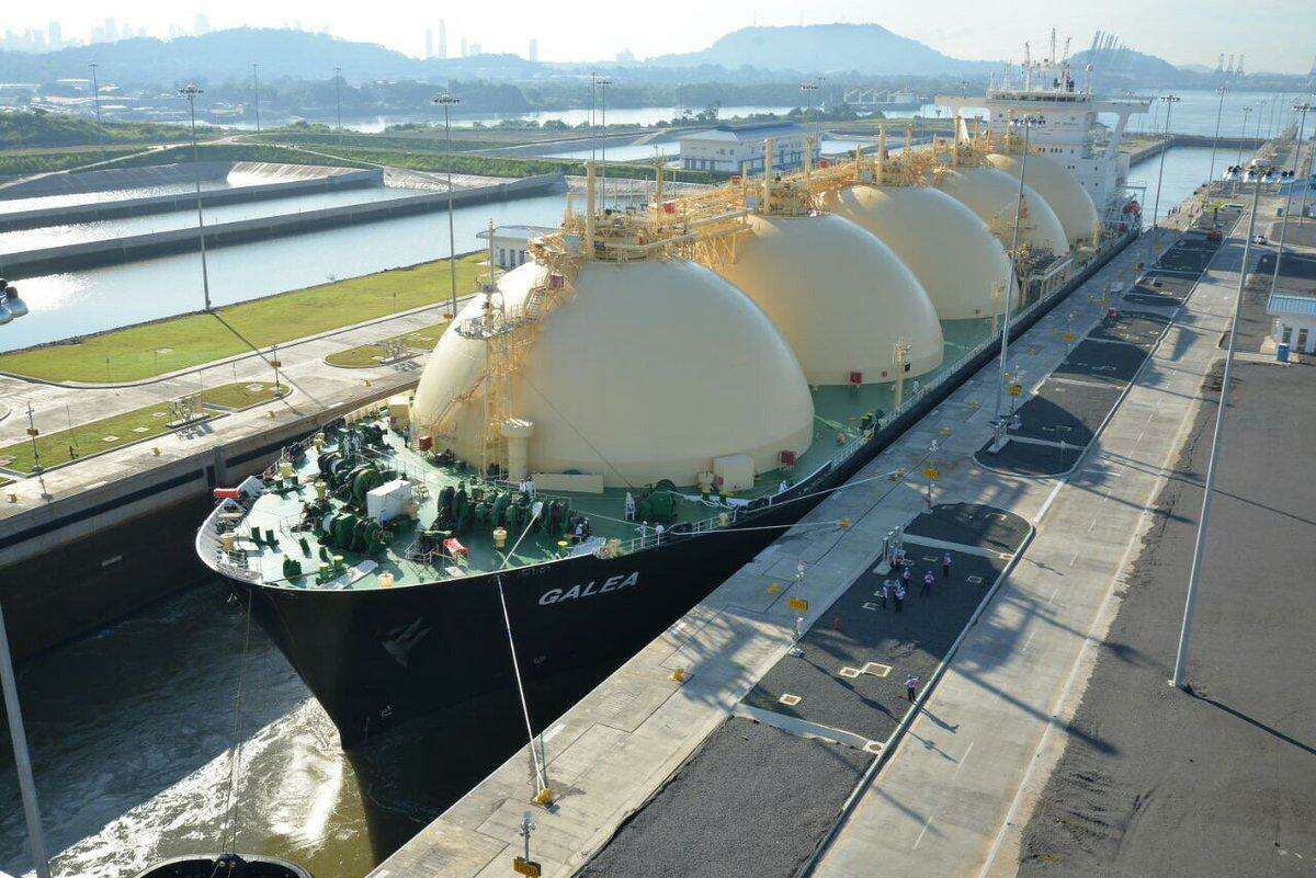 A liquefied natural gas tanker is shown going through the Panama Canal.